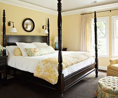 Four-Poster Beds in a pretty yellow room