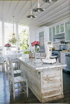 A porch kitchen!  I'd switch out those light fixtures for....  wait for it....  chandeliers!!!!