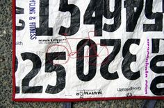 Amazing Tyvek Race Number Quilt!  Wow! @Kelly Mora heres something you could do with all those race numbers...very cool
