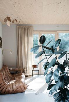 beautiful light living room with togo sofa