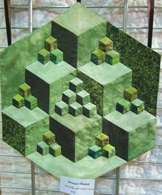 blocks created by dark, medium and light fabrics all in green. Geometric Quilt, Hexagon Quilt, Tumbling Blocks Quilt, Quilt Blocks, Paper Piecing, Quilting Projects, Quilting Designs, Optical Illusion Quilts, Optical Illusions