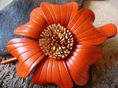 orange flower pin
