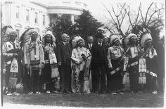 President Coolidge with members of the Sioux Indian Republican   Club of the Rosebud Reservation, on the White House Lawn, 1925.