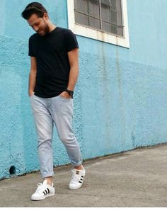 Men style outfit. Jeans, black shirt and adidas superstar.