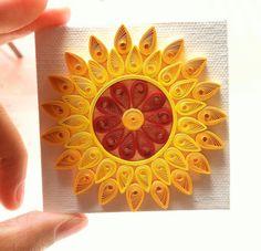 Quilled sun art.