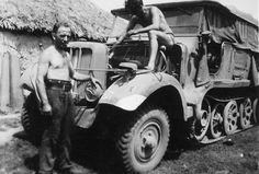 German soldiers of the engineering unit, 3rd Panzer Division (3. Panzer-Division), repare the engine of the Sd.Kfz. 6 on the Eastern Front.