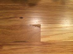 Indentation in floor where floorboard missing corner (13)