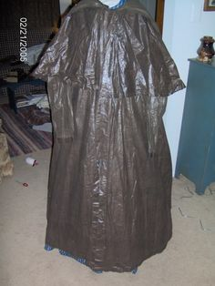 """1860s Raincoat in a private collection. """"The raincoat is made of the brown polished cotton usually seen in the linings of skirts and bodices.  However, it has been oiled to make the rain roll off it."""""""