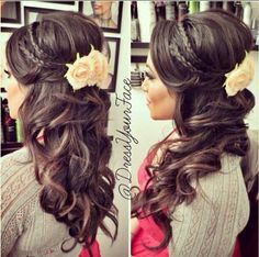 Half up half down do with curls, braids, and flowers