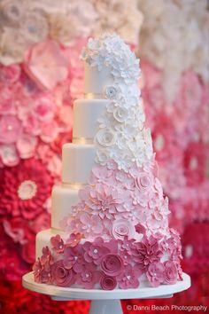 The fading of color gives an impact to these multi-layered cake! Pink floral details make this cake extremely beautiful!