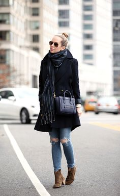 distressed jeans with black coat