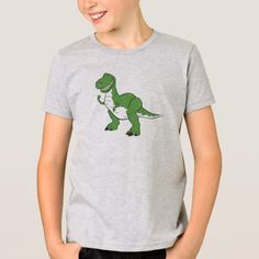 Cartoon Green Dinosaur Rex Disney T-Shirt. Whether you look up to the lovable Woody or the mischievous Buzz Lightyear, kids and adults alike will adore the cool collection of products we have to offer. Disney T Shirts, Toy Story Movie, Toy Story Birthday, Disney Merchandise, Shirt Style, Cartoons, Casual, Green, Woody