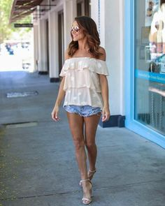Star spangled to perfection and just in time for the 4th of July! Our Star Spangled Off The Shoulder Top is stunning in this beige off the shoulder silhouette that's tiered and embroidered with ivory