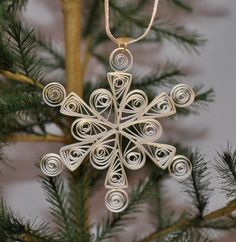 Paper Quilled White and Gold Paper Single Quilled Snowflake Ornament. $9.99, via Etsy.