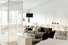Grey and white contemporary furniture setup by GRAND ROOM DESIGN