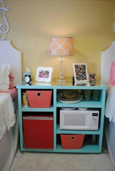 Cute side table with a mini fridge and microwave