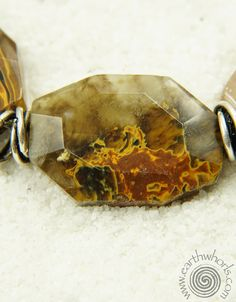 http://earthwhorls.com/collections/necklaces/products/1584sn  The flame of fashion in the heart of stone.