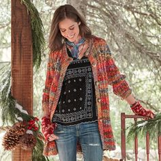 """LOVEJOY CARDIGAN--A brilliant display of Mother Nature's palette in softest, space-dyed yarn. Our exclusive cardigan with a variegated rib knit for shaping and playful, oversized buttons. Acrylic/wool. Hand wash. Imported. Exclusive. Sizes XS (2), S (4 to 6), M (8 to 10), L (12 to 14), XL (16). Approx. 32""""L."""