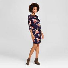 Baby bumps and style go hand in hand with this 3/4-Sleeve Floral Printed Lace-Yoke Dress from MaCherie. This fitted dress hugs your bump and shows it off in beautiful fashion. Lace detailing along the back and shoulders accentuates the feminine charm of the allover floral print. Pair with stacked booties or ballet flats for a more dressed up look, or go more casual with slip-on sneakers.