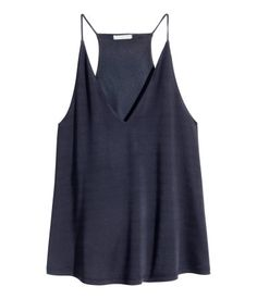 Flared, V-neck top in jersey with a sheen, with narrow shoulder straps and a racer back. Lined at the top.