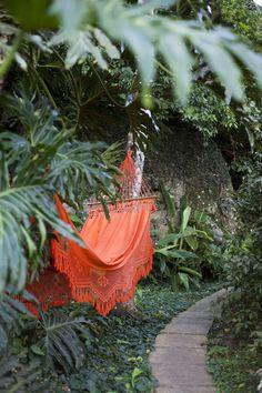Bohemian orange hammock in the garden