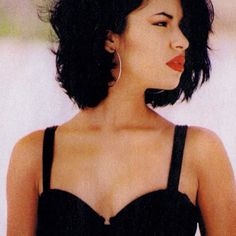 Selena with her red lips and bustier. RIP Selena Quintania.