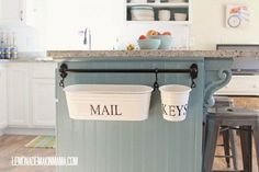 A lovely idea to use buckets to store important small things like mail and keys @istandarddesign
