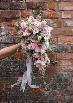 If you're planning on having your wedding in a church, you need to consider the best wedding flowers for your venue. You will have an easy time choosing church wedding flowers to. Bouquet Astilbe, Bouquet En Cascade, Cascading Wedding Bouquets, Rose Bridal Bouquet, Lily Bouquet, Wedding Flower Arrangements, Bride Bouquets, Bridal Flowers, Bridesmaid Bouquet