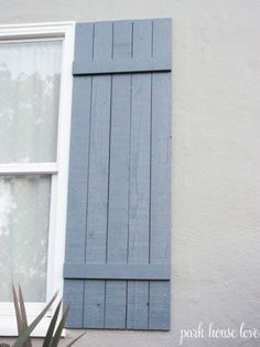 diy board and batten shutters  These could be easily made and great for storm protection.