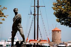 Statue in the harbor of Rhodes town, Greece