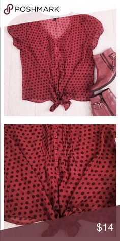 Mine burnt orange polka dotted blouse! Mine burnt orange polka dotted blouse with buttons down the shirt, Ties in waist! Size Small, true to size! Like New! Very cute and sheik! Make an offer now! Mine Tops Blouses