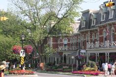 """The charming little town of Niagara-on-the-Lake is itself a major tourist attraction, and some refer to it as """"the prettiest town in Canada."""" The well-manicured village on the southern edge of Lake Ontario offers its visitors an abundance of flowers, early nineteenth century architecture, and the produce of a burgeoning wine industry."""