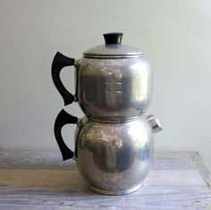Great old coffee pot. I would love to find a coffee pot like this! That thing is beautiful! Look at the curves on it!