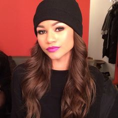 Her eyes. Her lipstick. That skully.