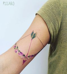 Floral bow and arrow tattoo by Pis Saro