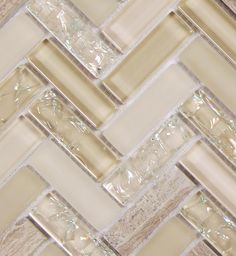 Herringbone backsplash with a beautiful combination of cracked glass, smooth glass and natural stone | Archery Light Beige Herringbone mosaic glass tile | herringbone tile | beige backsplash tile