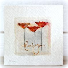 She used a negative of a die cut and colored with watercolors. Birgit on simplylessismoore