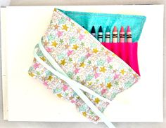 Keep crayons in one place with this crayon rollup that holds 24 crayons | Stylish star design with metallic gold, aqua and pink stars | Perfect stocking stuffer or birthday gift! Colored Pencil Holder, Twistable Crayons, Crayon Organization, Stocking Stuffers For Boys, Crayon Roll, Toddler Girl Gifts, Crayon Holder, Pink Stars, Birthday Gifts For Girls