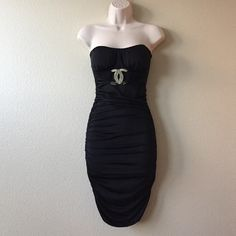 HP Black Strapless Scrunched Dress Only worn once. Above the knee/mini dress. Fitting, but flattering! Sexy! Ruched at the sides to show off your body! Thin built-in breast pads, so you don't need to wear a bra! Cute silver hardware. 92% Polyester 8% Spandex   Host Pick - 12/20 - Weekend Chic Party  Vizio Dresses
