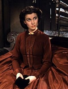 Vivien Leigh as Scarlett O'Hara in 'Gone With the Wind'. Scarlett has married for the second time to another man she doesn't love. Frank Kennedy, was the boyfriend of her younger sister Sue Ellen. She married him so he would pay the $300.00 in taxes owed on her family plantation, Tara.