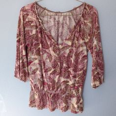 a.n.a Long sleeve pullover top. Print with detail. This top has 3/4  raglan sleeves with elastic at hem. Gathered elastic at neck with deep v and button detail. Elastic gather above hem bottom. Stretchy fabric. Sized at petite medium. Gently worn. a.n.a Tops