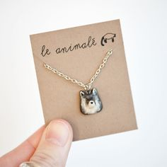 Itty bitty wolf necklace from le animalé