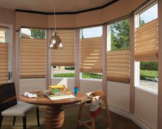 For those hard to fit windows...  http://blindandshuttergallery.com/2016/01/21/bay-window-treatments/
