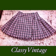 Abercrombie sun - wind sand skirt. Darling plaid skirt with frayed hem. Crossover front in a fun plaid . Third pic shows colors best. No rips tear is stains. Waist 26 and length 15.5. Abercrombie & Fitch Skirts
