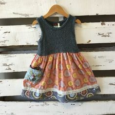 Matilda Jane wool top dress with mauve and buttercup patterned print skirt. Sweet sayings ribbon trims bottom of skirt and two front pockets. Size 4. Excellent condition!