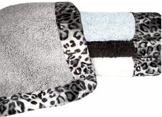 Snow Leopard Bordering Africa Animal Print Bath Rug.  $50.00 - $62.00 SALE $58.00,$44.00.
