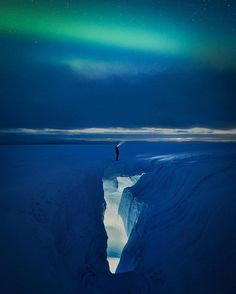 Just when you think Greenland could not be more epic, with its aurora & ice! Photo by Paul Zizka #Greenland #Green #blue #Aurora #nature #night #sky #photography