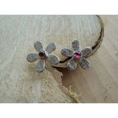 Caroline Cowen Jewellery Handmade Silver And Garnet Daisy Earrings (£45) ❤ liked on Polyvore featuring jewelry, earrings, garnet jewelry, hammered silver earrings, silver stud earrings, daisy stud earrings and silver jewelry