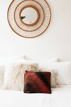 A vintage kilim pillow for your all white bedroom. Devine.