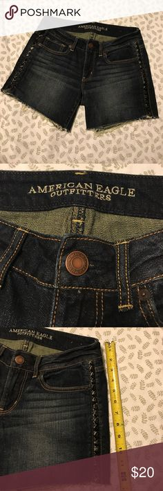 AMERICAN EAGLE SHORTS AMERICAN EAGLE JEAN shorts, size 8 (stretch). These are super cute, dark washed, and semi high waisted! They have a unique braided black leather-like material down both sides, and frayed bottoms! They have been lightly worn and they are in AWESOME condition! ❤️OFFER IF INTERESTED! American Eagle Outfitters Shorts Jean Shorts